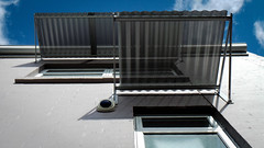 Semi-Transparent Metal Awnings (Theen ...) Tags: blue windows sky white building eye metal clouds silver iron paint apartment rear samsung securitycamera adelaide block residential corrugated awnings greenglass semitransparent gutters theen