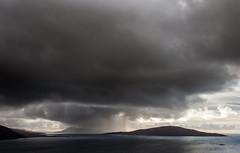 Rain between Chiapaval & Taransay 1 of 2 (Grim Weaver) Tags: sea mountains colour rain clouds canon scotland landscapes scenery mood seascapes canoneos canonrebelti canon500d