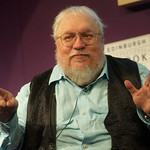George R R Martin on stage at the Edinburgh International Book Festival