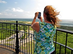 Woman taking photo from Cape Hatteras Lighthouse (SchuminWeb) Tags: pictures park county houses light sea woman lighthouse house smart june photography women buxton lighthouses phone ben nps photos balcony web north picture cell northcarolina hatteras smartphone national shore carolina take balconies cape service dare outer taking nationalparkservice shores outerbanks seashore banks phones obx capehatteras 2014 smartphones seashores capehatterasnationalseashore schumin schuminweb