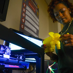 Tracy Foote White uses the 3-D printer in the Media and Education Technology Resource Center.