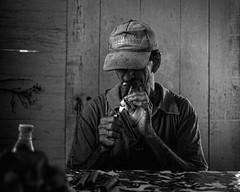 The Cuban tobacco grower and cigar maker enjoys his own work. (Time to try) Tags: havanacigar cigar smoking cuba farmer monotone blackandwhite lumix gx8 olympus olympus25mmf18 vanales mft microfourthirds timetotry copyrightbhammersley2016