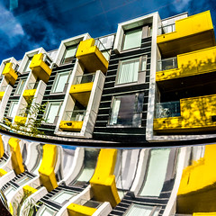Dystopian:Vision (BazM:Photog.......:-)) Tags: reflection colourful colour yellow distortion distorted manchester bazmatthews dystopia dystopian vision utopia apartmentblock apartments saturated leicac leica balconies square artistic northernquarter