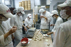 Hong Kong (jaumescar) Tags: hong kong asia restaurant cooking dumpling cantonese food group people cook white uniform kitchen work team hat precision effective mask