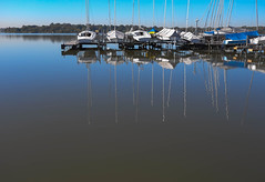 Dry Dock at White Rock Lake (www.higbyphotography.com) Tags: morning blue dock texas mirror reflection dallas whiterocklake boats lake water
