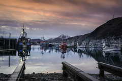 Early sunset in Kodiak. (rishaisomphotography) Tags: kodiak alaska harbor fishing boats ocean sea bay town sunset sky pillarmountain turbines mountains clouds landscape nature naturephotographer dock thanksgiving night dusk winter deepnorth pier