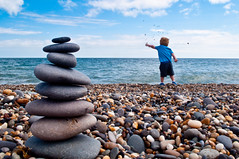 Simple Pleasures (rich_walters) Tags: boy beach nikon stones rich pebbles stack richard throw walters d5000 richwalters