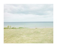 Grass, fence, sea and sky. (crabsticky1) Tags: holiday beach grass fence landscape seaside quiet lawn tranquil seasky