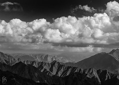 Sons of the Mountains (CephaloviA (Hussain Al-Kahtani)) Tags: white black mountains monochrome clouds landscape 50mm f14 olympus saudi arabia zuiko  asir