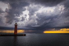 stormy evening at the lighthouse (olsonj) Tags: sunset orange lighthouse lake storm colors rain clouds glow lakemichigan