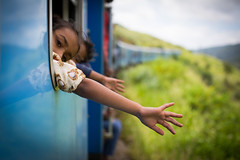 train girl (paul.wienerroither) Tags: travel portrait girl train canon photography 50mm hand view ride highland srilanka primes srilankarailroadscenery