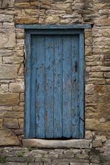 Blue Door (stumpy man) Tags: door blue texture stone handle peeling paint flake horseshoe peel flaky cracked