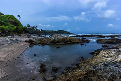 Vagator Beach (Pathikrit Gupta) Tags: ocean road blue sea portrait sky food green beach water rain lady canon fun photography highway waves goa monsoon lonely coulds impressionist