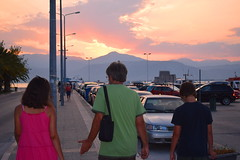 In the heat of the discussion (mi ne volimo alu) Tags: street mountains people sunset greece perspective blue orange outdoor urban purple citylife candid pink green colour hill illumination landscape light nafplio back