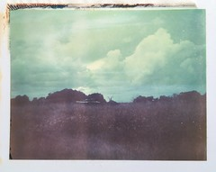 Polaroid Week Day Five - When the Clouds Came (dreamscapesxx) Tags: instant polaroid peelapart supershooter polaroid669film expiredfilm inthecountry stormsrollingin cloudsbuilding abandonedbuildings emptyfields lateevening seffnerfl snapitseeit polaroidweek dayfive