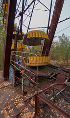 Pripyat Amusement Park (Chernobyl Exclusion Zone)_2 (Landie_Man) Tags: none pripyat chernobyl ionising radiation radioactive fair fairground amuse amusements amusement park may day parade soviet union ussr cccp disused abandoned forgotten left sad never opened ran communism communist fun ferris wheel bumper cars dodgems swing ride swings nature reclaim redstar red star cliche clche