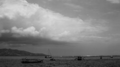 A Cloudy Day near the Gilis (HansPermana) Tags: bali indonesia cloud blackandwhite storm sea monochrome dramatic boats mountain water