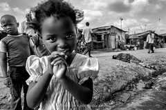 Contrasts: Curiosity & diffidence, desperation & indifference. (Tony Corocher) Tags: tonycorocherallrightsreserved 2013 2015 abuse africa aid baraccopoli beautyinhell beautyoverdrama blackandwhite blackwhite challenges child children crisis documentary ghetto hardconditions help humanrights humanitarian journalism kenya kibera mathare nairobi photojournalism poverty reality refugeecamps reportage slum slums streetlife streetphotography survival survive thehumanstory tonycorocherphotography travel tonycorocherculture tonycorocherallrightsreserved