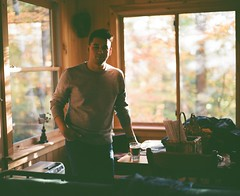 Brother (Nick Spadaro) Tags: medium format film pentax 67 portrait window glass light cabin woods fall autumn adirondacks