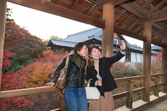 Two women taking selfie picture in Japanese fall foliage (Apricot Cafe) Tags: canonef2470mmf28liiusm img7588 asianethnicity japan japaneseethnicity autumn autumnleaves beautyinnature bridge change charming cheerful enjoying foliage freshness happiness hope japanesefallfoliage japanesemaple leaves mapleleaf nature onlywomen outdoors people refreshing selectivefocus selfie smartphone smiling takingpictures toothysmile tranquility traveldestinations twopeople walking woman youngadult