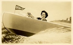 I Don't Know Where I'm Going But I'm on My Way! (Alan Mays) Tags: ephemera postcards realphotopostcards rppc photos photographs portraits souvenirphotos souvenirs foundphotos backdrops studioprops boats motorboats speedboats studioboats oceanview pennants flags water waves beaches women smiles smiling amusing humor humorous funny antique old vintage photographicamusements