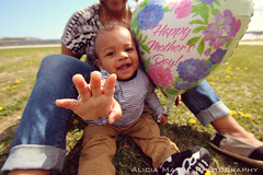 (Alicia Masse Photography.) Tags: boy baby cute beach boys hat smiling kids laughing portraits balloons happy photography day babies adorable swing nike mothers cheeks swinging chubby playgrounds
