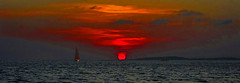 Swahili Sunset (Pan) (david schweitzer) Tags: dreamscape landscape swahilidhowseries dhowculture seascape handcrafted arabicstyled mashua fishing dhow sunset orange sun red sky indianocean kenya swahili coast panorama lamu archipelago silhouettes equator davidschweitzer documentaryphotography streetphotography