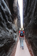 The Line (Jane Inman Stormer) Tags: light nature beauty hat rock vertical stone walking utah sand sandstone hiking path canyon hike explore trail canyonlandsnationalpark hiker redrock narrow camelback slotcanyon newbalance explored