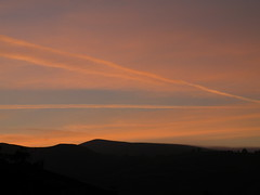 dawn chemtrails (rospix) Tags: uk pink blue sky orange cloud nature weather silhouette june wales clouds sunrise dawn countryside pattern stripes hills chemtrails 2014 globaldimming geoengineering weathermodification rospix solarradiationmanagement stratosphericaerosolspraying