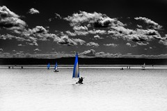 Blue Sails (Tony Shertila) Tags: blue england sky people blackandwhite colour water clouds river walking boat europe yacht britain desaturation processing sail dee hdr wirral westkirby merseyside twotone partialdesat westkirbymarina
