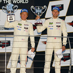 Patrick Long and Michael Christensen celebrate on the Indy Podium