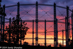 Beauty and the Beast (Explored) (Sandy Sharples) Tags: blue sunset red orange silhouette manchester design iron industrial tank britain structure gasometer stretford