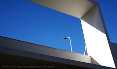 Blue sky and concrete (John Twohig Photography) Tags: bridge blue white lamp architecture angle simple