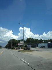 Large Cumulus Clouds (sheriffdan10) Tags: road street sky clouds buildings wires lakecountyindiana