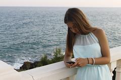 Noelia (maffotografias) Tags: ocean blue friends sea girl earings mobile crazy pretty phone dress blonde cousin bluesea