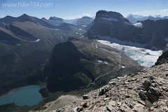 "Grinnell Glacier Basin with Grinnell Lake • <a style=""font-size:0.8em;"" href=""http://www.flickr.com/photos/63501323@N07/14919076740/"" target=""_blank"">View on Flickr</a>"