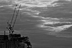 Cranes (juliendbg) Tags: bw london thames skyline night clouds dark nb cranes londres nuages nuit grues tamise