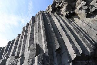 Stuðlaberg basalt columns on Reynisfjara beach near Vik