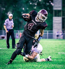 High school football: tackle (rikki480) Tags: game field ball football break play stadium indiana run highschool concordia lutheran grab bishop carrier tackle fortwayne evade elude zollner dwenger