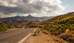 Autumn road. (Hayk Senekerimyan) Tags: road autumn trees sky mountains fall cars leaves lines clouds turn bush nikon october rocks colorful rows armenia directions af nikkor asphalt heights volcanic tops d3