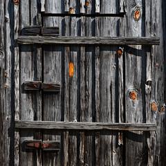 Door (davidwilliamreed) Tags: door wood old metal decay grain rusty textures weathered knots crusty patina hinges jordanmill washingtoncountyga