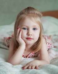 Little cute girl with blue eyes lying on a bed (SeattleHVAC172) Tags: morning portrait girl beautiful closeup sleep comfortable cute health person pretty child rest face small hair kid home caucasian childhood one relax dream daughter expression resting comfort awake adorable