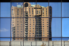 city reflections (Lucie Maru) Tags: urban architecture building midwest distor reflect glass windows distorted streched mirror glasswindows balconies city appartments condos