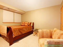 Simple basement level guest bedroom with bed and chair. (adambebenek) Tags: bedroom room apartment beautiful clean comfortable interior design bed furnished furniture empty nightstand pillow window floor doors realestate style simple image photography royaltyfree photo designer idea architecture project building american northwest inside indoors carpet open bright home house modern armchair single guest greenwalls gardenlevel basement