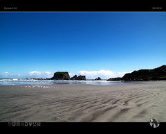 Another Blue View (tomraven) Tags: island wallisland taurangabay westcoast newzealand sand sea sky clouds sun waves water rocks tomraven aravenimage q32016 pentax k50