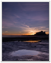 Across the rocks at Bamburgh (Blondie606 Photography) Tags: bamburghcastle sunrise sunset northumberland beach sea steetlypier longexposure lighhouse newcastlequay pastel frosty golden boats chemicalbeach seaham hartlepool