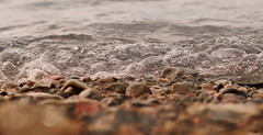 Effervescence (charhedman - on and off) Tags: waves shore bubble water rocks ocean macro bokeh