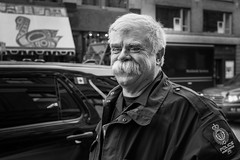 Vancouver's finest 'stache (johnjackson808) Tags: fujifilmxt1 gastown movember police vancouver waterst bw blackandwhite cop monochrome moustache people streetphotography