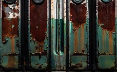 Ingression (Junkstock) Tags: aged abandoned color corrosion corroded decay decayed distressed door doors green kennebunkport maine nostalgic nostalgia newengland old oldstuff oldandbeautiful obsolete photo photograph photography photographs photos patina paint peelingpaint relic rust rusty rustyandcrusty rusted railroad rivets textures texture transportation transport trains train trolley trolleys vintage weathered