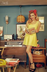 The yellow housewife ft. Ellie Rousou: reading (SpirosK photography) Tags: ellierousou vintage retrosexual athens greece   pinup pinupphotography spiroskphotography veniaandreou alvina alvinahairstyles newskinclothes newskin elisavetlatsiou portrait yellow housewife reading